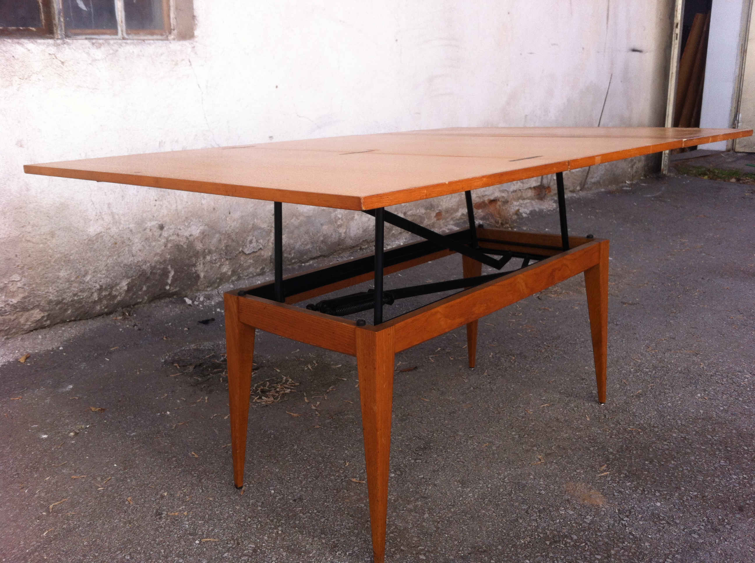 Wooden Countertops And Legs, Metal Expandable Structure. The Table Rises To  A Height And The Table Stretches To Three Times. Very Good Condition. 1960s.